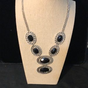 Jewelry - Black necklace with six circular gems